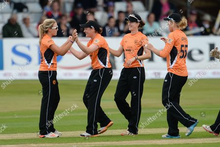 Katie George (l) and Arran Brindle, Lydia Greenway & Georgia Adams celebrate the wicket of Heather Knight during the Women's Cricket Super League final between Southern Vipers and Western Storm at the Essex County Ground, Chelmsford