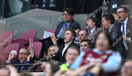 West Ham co-owner David Sullivan reacts after a chance near the end alongside his wife and boys with Daily Mail columnist Martin Samuel present a couple of rows behind them during the Premier League match between West Ham United and AFC Bournemouth played at The London Stadium on 21st August 2016