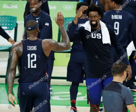 United States' DeMarcus Cousins (12) and teammate DeAndre Jordan celebrate during the men's gold medal basketball game against Serbia at the 2016 Summer Olympics in Rio de Janeiro, Brazil