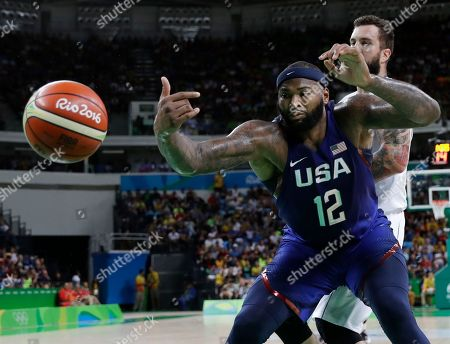 United States' DeMarcus Cousins (12) reaches for the ball against Serbia during the men's gold medal basketball game at the 2016 Summer Olympics in Rio de Janeiro, Brazil