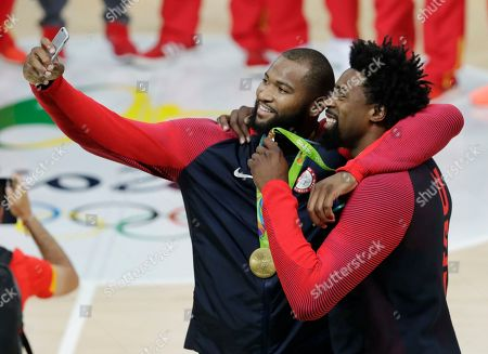 United States' DeMarcus Cousins and DeAndre Jordan, right, take a selfie with their gold medals for men's basketball at the 2016 Summer Olympics in Rio de Janeiro, Brazil