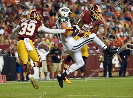 Zach Sudfeld, Lloyd Carrington, Geno Matias-Smith New York Jets tight end Zach Sudfeld (44) catches a touchdown pass between Washington Redskins safety Geno Matias-Smith (39) and cornerback Lloyd Carrington (25) during the second half of an NFL preseason football game, in Landover, Md