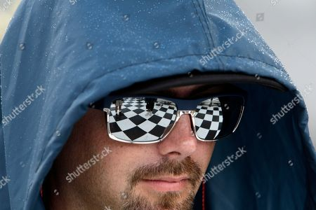 The checker board of Victory Lane is reflected in the glasses of Jason Roberts during a NASCAR Sprint Cup auto race, in Bristol, Tenn
