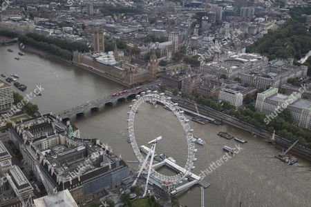 The River Thames passes under and Westminster Bridge. The London Eye/Millennium Wheel and The London Aquarium (below left) and The Palace of Westminster (Elizabeth Tower/Big Ben, Houses of Parliament), and Portcullis House, (top centre) next to Westminster Abbey and Parliament Square, and HM Treasury and St James's Park (top right)