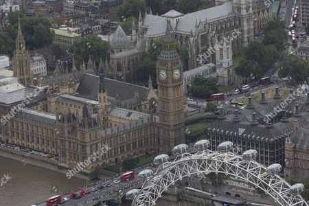 The London Eye/Millenium Wheel in front of Westminster Bridge, The Palace of Westminster (Elizabeth Tower/Big Ben, Houses of Parliament), Portcullis House, (right), Parliament Square, and Westminster Abbey (top left)