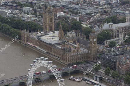 The London Eye/Millenium Wheel in front of The River Thames, Westminster Bridge, The Palace of Westminster (Elizabeth Tower/Big Ben, Victoria Tower, Houses of Parliament), Portcullis House, (right), Parliament Square, and Westminster Abbey (top left)