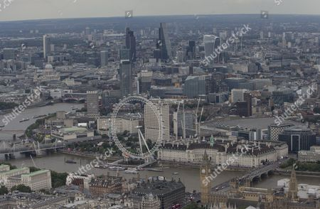 The London Eye, Millennium Wheel (below centre) in-between the South Bank, Hayward Gallery and the London Aquarium, Waterloo Bridge and Hungerford Bridge and Golden Jubilee Bridges (below left). The River Thames next to Westminster Bridge, behind The Palace of Westminster (Elizabeth Tower/Big Ben, Houses of Parliament) and Portcullis House (below left) St Marys Axe (The Gherkin), Tower 42, Leadenhall Building and 20 Fenchurch Street and Heron Tower  (top)