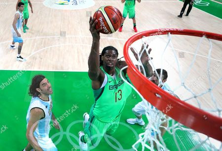 Nene Hilario, Luis Scola Brazil's Nene Hilario (13) drives to the basket  past Argentina's Luis Scola (4) during a men's basketball game at the 2016 Summer Olympics in Rio de Janeiro, Brazil