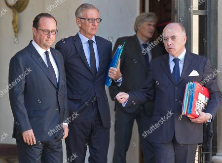 French President Francois Hollande, left, French Junior Minister of Foreign Affairs Andre Vallini and French Interior Minister Bernard Cazeneuve talk in the lobby after the first cabinet meeting since the summer break at the Elysee Palace in Paris