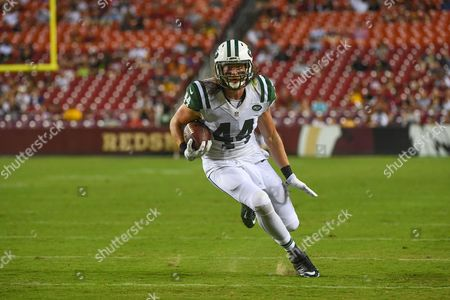 New York Jets tight end Zach Sudfeld (44) rushes with he ball after a reception during the pre-season matchup between the New York Jets and the Washington Redskins at FedEx Field in Landover, MD