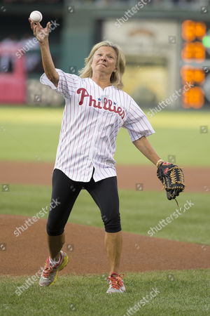Author Lisa Scottoline throws out the first pitch prior to the MLB game between the St. Louis Cardinals and Philadelphia Phillies at Citizens Bank Park in Philadelphia, Pennsylvania. The Philadelphia Phillies won 4-2