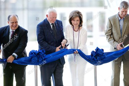 Maher Maso, Jerry Jones, Gene Jones, Dr. Jeremy Lyon From left, Frisco Mayor Maher Maso, Dallas Cowboys Owner, President and General Manager Jerry Jones, wife Gene Jones, and Frisco ISD Superintendent Dr. Jeremy Lyon cut a ceremonial ribbon to open the Ford Center at The Star,  in Frisco, Texas