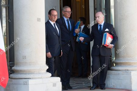 French President, Francois Hollande, French junior minister for Development and Francophony, Andre Vallini and French Interior minister, Bernard Cazeneuve leave after the weekly cabinet meeting at Elysee Palace