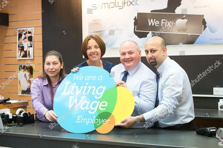 Kezia Dugdale and store owner Scott Wilkinson with some of his staff