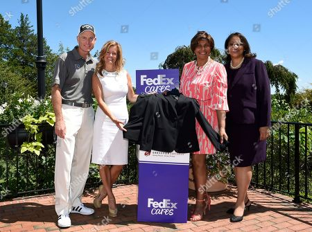 Stock Image of 2010 FedEx Cup Champion Jim Furyk and his wife Tabitha join Rose Flenorl, FedEx Manager of Social Responsibility and Joi Gordon, CEO of Dress for Success, to launch a women's professional clothing drive at The Barclays on  in Farmingdale, N.Y. Fans can visit @FedEx on Twitter for more information on how they could receive a free ticket to the tournament