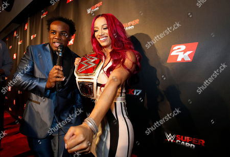 Sasha Banks, Xavier Woods WWE Women's Champion Sasha Banks speaks with WWE Superstar Xavier Woods, left, on the red carpet at the WWE 2K17 SummerSlam Kickoff Event in New York, on