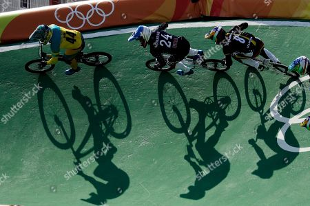 Cyclists, from left, Anthony Dean of Australia, Corben Sharrah of the United States and Carlos Ramirez Yepes of Colombia compete in the men's BMX cycling semifinal during the 2016 Summer Olympics in Rio de Janeiro, Brazil