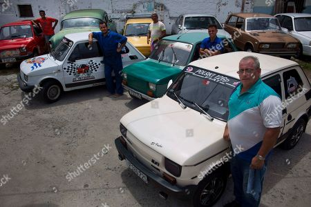 Fiat Polski 126p, owners Raul Seoane, left,  Ramses Fernandez, second left, Evilio Aguilar, center, Rigoberto Mesa, second right, and Pedro Fernandez, proudly pose with their cars in Havana, Cuba, . With around just 24 horsepower, depending on exactly how each one has been altered, the half-ton Polski offers families a shot at independent mobility for a few thousand dollars, a sum within reach of those able to save from private jobs or family sending money from overseas