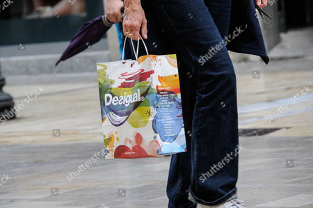 pedestrians with shopping bags Desigual