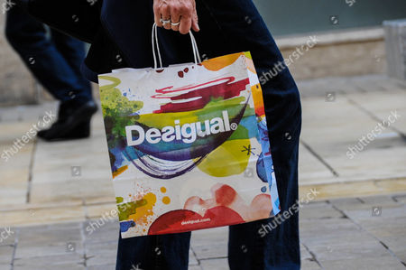 Stock Picture of pedestrians with shopping bags Desigual