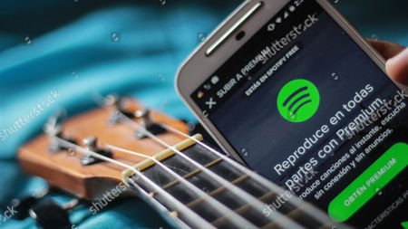 application of Spotify with a guitar