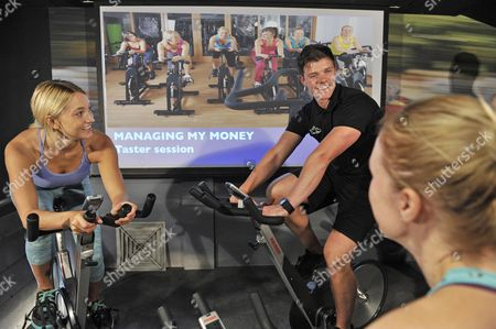 Melissa Wells views the Open University's Managing My Money course as she enjoys a taster session at David Lloyd Clubs to launch the university's new Brain Gyms campaign - urging people to exercising their minds.
