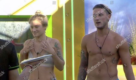 Katie Waissel and Stephen Bear prepare to receive a pie in the face