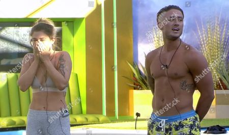 Katie Waissel reacts after Stephen Bear pushes a pie in the face of Aubrey