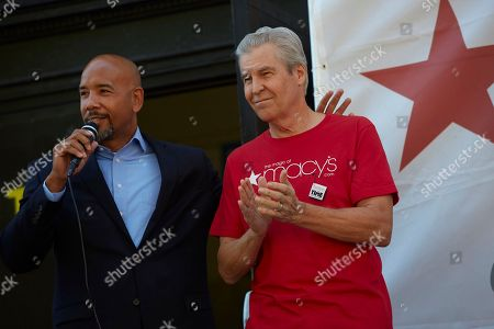 Macy's 11th Annual Give Back Day at the William Howard Taft Educational Complex in the Bronx borough of New York,. Bronx Borough President Ruben Diaz Jr, left, and Macy's Chairman and CEO Terry J. Lundgren address a crowd of 400 volunteers