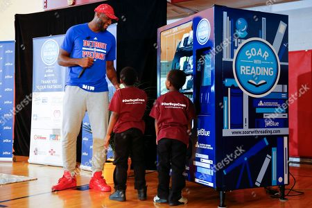 Andre Drummond Detroit basketball player Andre Drummond shows kids a custom book vending machine during JetBlue's Soar with Reading event at The Matrix Center, in Detroit. JetBlue's Soar with Reading installed five custom book vending machines to distribute free books to children in Detroit all summer long