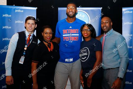 Thomas Ludke, Porsche Laster, Andre Drummond, Chantel Moore, Samora Emmanuel Thomas Ludke, left to right, Porsche Laster, Detroit basketball player Andre Drummond, Chantel Moore and Samora Emmanuel during JetBlue's Soar with Reading event at The Matrix Center, in Detroit. JetBlue's Soar with Reading installed five custom book vending machines to distribute free books to children in Detroit all summer long