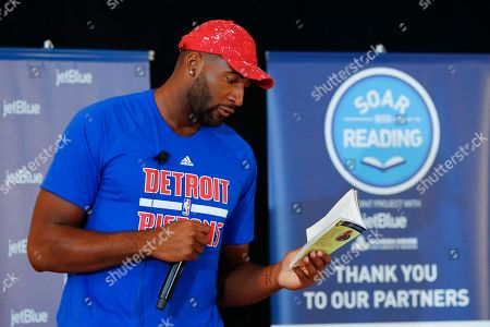 Andre Drummond Detroit basketball player Andre Drummond reads to local children during JetBlue's Soar with Reading event at The Matrix Center, in Detroit. JetBlue's Soar with Reading installed five custom book vending machines to distribute free books to children in Detroit all summer long
