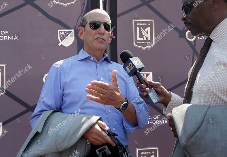 Major League Soccer Commissioner Don Garber speaks in an interview at a groundbreaking ceremony for a stadium, which will be home to the Los Angeles Football Club in Los Angeles. The $350 million stadium will house Southern California's newest soccer team. Some team owners werehand for Tuesday's groundbreaking, including Los Angeles Lakers legend Magic Johnson, actor Will Ferrell and motivational speaker Tony Robbins