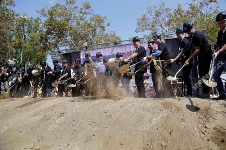 Investors and co-owners break ground during a ceremony for the Los Angeles Football Club stadium in Los Angeles. The $350 million stadium will house Southern California's newest soccer team. Some team owners werehand for Tuesday's groundbreaking, including Los Angeles Lakers legend Magic Johnson, actor Will Ferrell and motivational speaker Tony Robbins