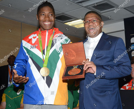 Sports and Recreation Minister Fikile Mbalula poses with Caster Semenya at the OR Tambo airport