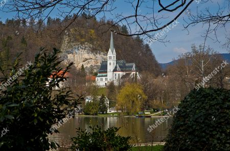 A church is seen on the shore of Lake Bled, northern Slovenia. It was at the lakeside Grand Hotel Toplice in Bled where Melanija Knavs, who later changed her name to Melania Knauss, introduced Donald Trump to her parents during their brief visit to Slovenia in July 2002, two years before they engaged. It is believed that it was the last time that the former model visited her native country