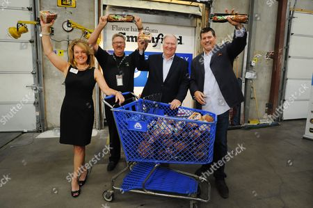Stock Photo of Mark Schlereth joins representatives from Smithfield, Food Bank of the Rockies and Albertsons/Safeway for a donation event as part of Smithfield's Helping Hungry Homes tour at Food Bank of the Rockies on  in Denver. The 25,000-pound protein donation will provide more than 100,000 servings to Colorado families in need
