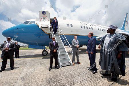 U.S. Embassy Abuja Deputy Chief of Mission Lord Young awaits U.S. Secretary of State John Kerry as he deplanes