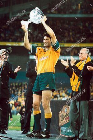 John Eales lifts the Tom Richards Trophy for Australia. Australia v British Lions, 3rd Test, Stadium Australia, Sydney, New South Wales, . Credit: Colorsport / Matthew Impey