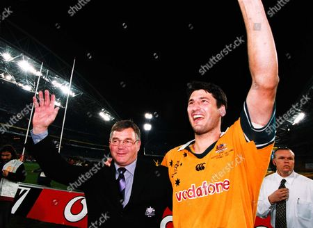 Australia coach Rod Macqueen waves to the crowd after his final match with Captain John Eales. Australia v British Lions, 3rd Test, Stadium Australia, Sydney, New South Wales, . Credit: Colorsport / Matthew Impey