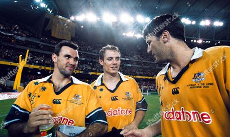 (l-r) Joe Roff, Stephen Larkham and John Eales celebrate Australia's victory. Australia v British Lions, 2nd Test, Colonial Stadium, Melbourne, Victoria, 7/07/2001. Credit: Colorsport / Matthew Impey