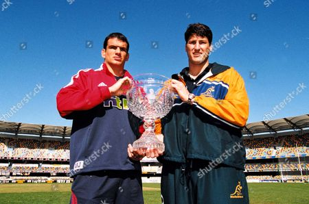 Captain's Martin Johnson (Lions, left) and John Eales (Australia) pose with the Tom Richards Trophy at the Gabba Stadium, venue for the 1st Test Match. Brisbane, Queensland, . Credit: Colorsport / Matthew Impey