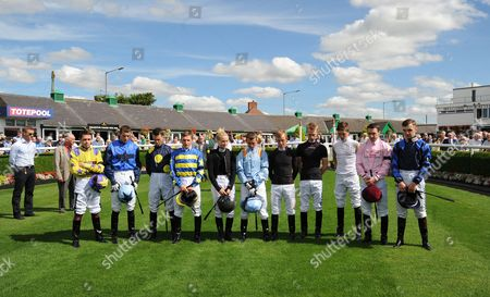 Jockeys pay their respects to Tom O'Ryan in a minutes silence before racing CATTERICK RACECOURSE (R-L) Adam Ryan, Jack Berry, Andrew Mullen, Neil Farley, Graham Lee, P.J.McDonald, Danielle Mooney, David Allan, Ben Curtis, Joey Haynes, Kevin Stott, Paddy Mathers, Connor Beasley.