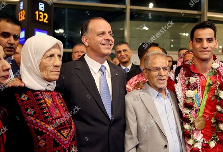 Ahmad Abughaush, Faisal Bin Al Hussein Jordanian Prince Faisal Bin Al Hussein, center left, poses with the parents of taekwondo gold medal winner in the 2016 Olympics, Ahmad Abughaush, right, on his arrival to the Queen Alia International Airport in Amman, Jordan. Abughaush, Jordan's first Olympic champion, returned home to a royal welcome. The 20-year-old was greeted by three princes and a cheering crowd at the kingdom's main airport, after his return from the Rio games. Abughaush says he'll seek to defend his title at the 2020 Olympics in Tokyo