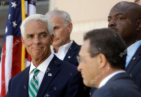 Charlie Crist Former Florida Gov. Charlie Crist, left, smiles during a news conference in St. Petersburg, Fla. Crist is running as a Democrat for the U.S. House of Representatives for the 13th District in Florida