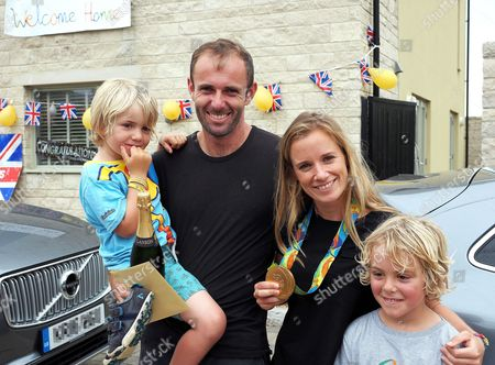 Medal winners Nick Dempsey (silver) and Hanna Mills (gold) from Rio 2016 who live at Portland Dorset where their neighbours turned out to welcome them by decorating their home at Fortuneswell. Nick arrived home early but the real surprise was for Hannah who had no idea what the the residents had in store for her return later this afternoon. (Wed) Nick's children are Oscar, left and Thomas, right.
