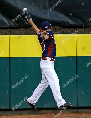 Stock Image of Justin Ryan Endwell, N.Y., left fielder Justin Ryan just misses a three-run home run by Bowling Green, Ky.'s Carson Myers during the first inning of a baseball game at the Little League World Series in South Williamsport, Pa