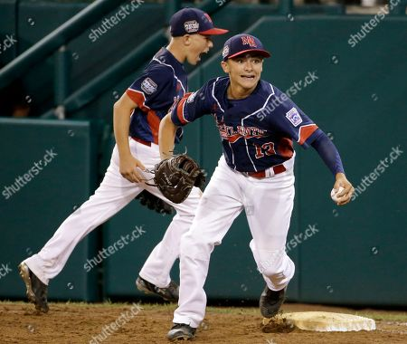 Jack Hopko, Justin Ryan Endwell, N.Y., first baseman Jack Hopko (13) begins to celebrate with teammate Justin Ryan, rear, after getting the final out of a baseball game against Bowling Green, Ky., at the Little League World Series in South Williamsport, Pa., . New York won 13-10