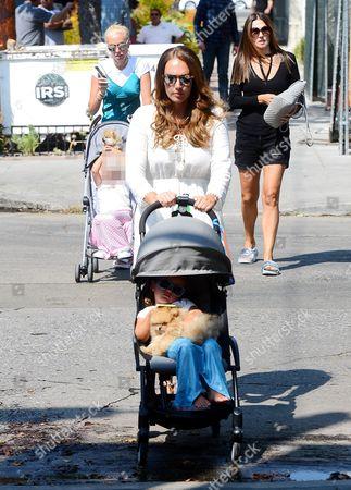 Tamara Ecclestone and daughter Sophia Ecclestone-Rutland with Petra Stunt and daughter Lavinia Stunt