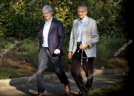Stock Photo of Tim Cook, David Podesta Apple CEO Tim Cook, left, and John David Podesta, Chairman of the 2016 Hillary Clinton presidential campaign, are seen through the window of the media motorcade van as they leave a fundraiser for Democratic presidential candidate Hillary Clinton in Los Altos Hills, Calif